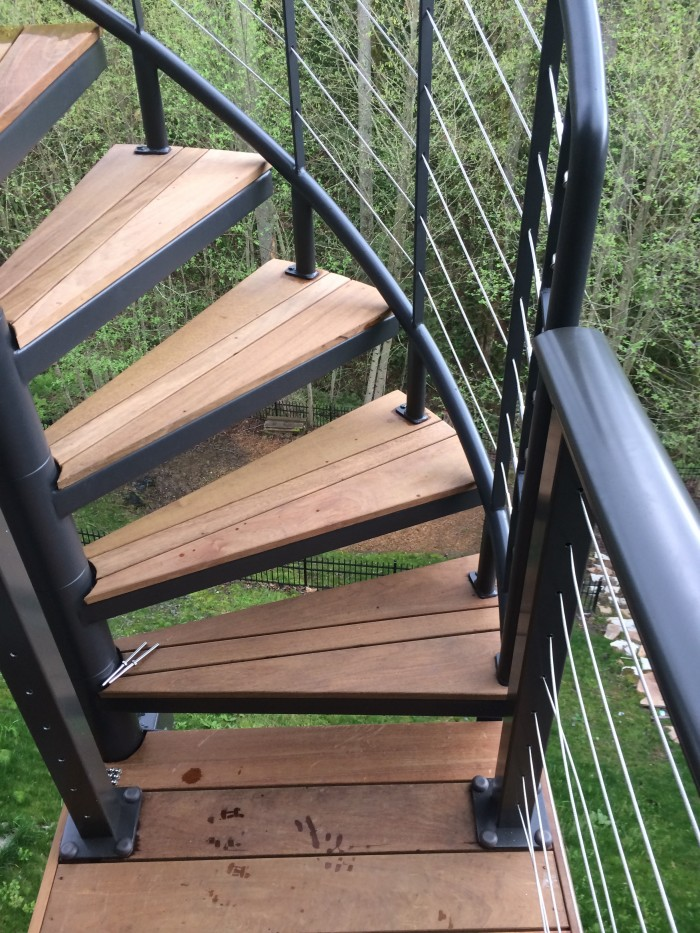 Custom Circular Staircase On Elevated Ipe Deck In Forest